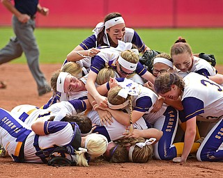 AKRON, OHIO - JUNE 1, 2019: Members of the Champion softball team dog pile on the field in celebration after defeating Cardington-Lincoln 5-0 to win the Division III State Softball Championship, Saturday morning at Firestone Stadium. DAVID DERMER | THE VINDICATOR