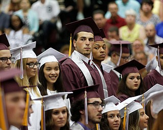 Augustino Arcuri, center, stands with his classmates during Boardman's commencement ceremony in the school's gym on Sunday afternoon. EMILY MATTHEWS | THE VINDICATOR