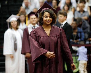 Yelisa Cortez walks up to receive her diploma during Boardman's commencement ceremony in the school's gym on Sunday afternoon. EMILY MATTHEWS | THE VINDICATOR