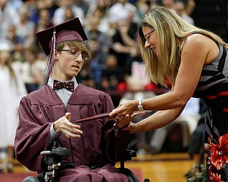 Blake Windt receives his diploma from Boardman Board of Education Vice President Victoria Davis during Boardman's commencement ceremony in the school's gym on Sunday afternoon. EMILY MATTHEWS | THE VINDICATOR