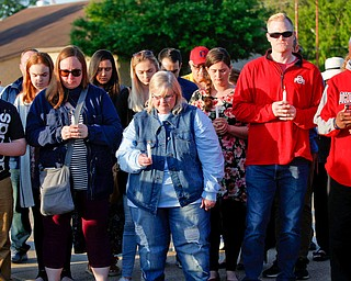 People who are gathered for a vigil to honor Brad and Jacob Crist, who died in a house fire in Niles last week, take a moment of silence at the Niles Safety-Service Complex on Sunday evening. EMILY MATTHEWS | THE VINDICATOR