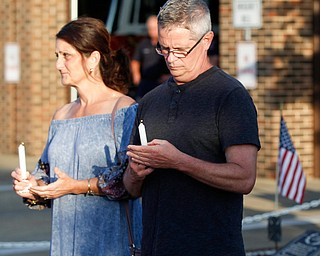 Mary Jo and Leonard Blount, cousins of Brad and Jacob Crist, hold candles in honor of Brad and Jacob, who died in a house fire in Niles last week, during a vigil for them at the Niles Safety-Service Complex on Sunday evening. EMILY MATTHEWS | THE VINDICATOR