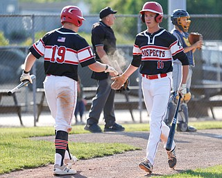 Prospects' Carter Chinn, left, and Mike Fetzko high-five after Fetzko scores during their game against Whiting at Bob Cene Park on Monday evening. EMILY MATTHEWS | THE VINDICATOR