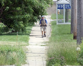 ROBERT K.YOSAY  | THE VINDICATOR...vetsdontforgetvets.com.William Shuttleworth is  on a 7-month walk across America from Massachusetts to California, ÒVets DonÕt Forget VetsÓ as he came through Youngstown on Tuesday...walking up St Rt 62