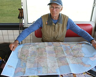ROBERT K.YOSAY  | THE VINDICATOR...vetsdontforgetvets.com.William Shuttleworth is  on a 7-month walk across America from Massachusetts to California, ÒVets DonÕt Forget VetsÓ as he came through Youngstown on Tuesday...the united states map