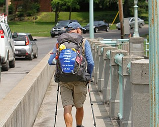 ROBERT K.YOSAY  | THE VINDICATOR...vetsdontforgetvets.com.William Shuttleworth is  on a 7-month walk across America from Massachusetts to California, ÒVets DonÕt Forget VetsÓ as he came through Youngstown on Tuesday...walking by the Old Mill in Mill Creek Metroparks