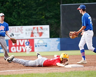 Mahoning County's Brett Porter, of Austintown Fitch, tries to throw the ball to Dan Windham, of Western Reserve, as Trumbull County's Preston Rapczak, of Newton Falls, dives back to first during the 2019 High School Valley All Star Classic at Eastwood Field on Friday evening. EMILY MATTHEWS | THE VINDICATOR