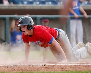 Trumbull County's Jamie Thompson, of Hubbard, dives into home to score the game-winning run during the 2019 High School Valley All Star Classic at Eastwood Field on Friday evening. Trumbull County won 4-3. EMILY MATTHEWS | THE VINDICATOR