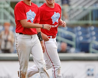 Trumbull County's Austin Clausel, the MVP of the game, left, and Nick Degregory, both of Girard, celebrate after beating Mahoning County 4-3 in the 2019 High School Valley All Star Classic at Eastwood Field on Friday evening. EMILY MATTHEWS | THE VINDICATOR