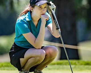 DIANNA OATRIDGE | THE VINDICATOR Taylor Bycroft, 16, of East Palestine, reads the green during the Greatest Golfer of the Valley Junior Qualifier at Pine Lakes in Hubbard on Tuesday.