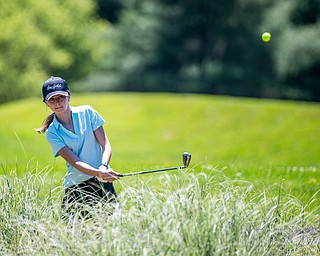 DIANNA OATRIDGE | THE VINDICATOR Olivia Csee, 15, of Canfield, watches her chip shot during the Greatest Golfer of the Valley Junior Qualifier at Pine Lakes in Hubbard on Tuesday.