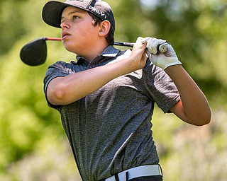 DIANNA OATRIDGE | THE VINDICATOR Nolan Williard, 15, from Canfield, watches his tee shot on Hole No. 7 during the Greatest Golfer of the Valley Junior Qualifier at Pine Lakes in Hubbard on Tuesday.