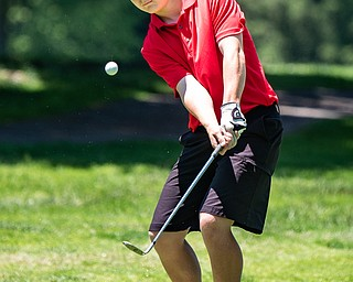 DIANNA OATRIDGE | THE VINDICATOR Tyler Andersen, 16, of Columbiana, watches his chip shot during the Greatest Golfer of the Valley Junior Qualifier at Pine Lakes in Hubbard on Tuesday.