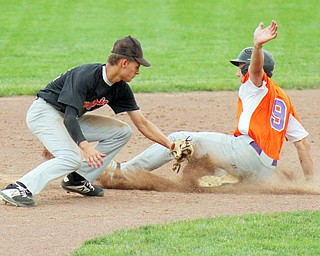 William D. Lewis The vindicatotr  Creekside's Dylan Gurski(9) steals 2nd as Knightline's Mason McCurdy(22) tries to make the tag during 6-12-19 action at Cene.