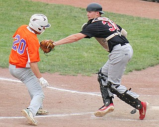 William D. Lewis The Vindicator   Creekside's Nic Ottaviani(20) is tagged at the plate by Knightline's John Ritter(38) during 6-12-19 action at Cene.