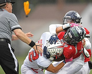 NILES, OHIO - JUNE 13, 2019: Mahoning County's Ralph Fitzgerald, red, and Trumbull County's Benton Tennant fight in the first half of their game, Thursday night at Niles McKinley High School. Trumbull County won 10-6. DAVID DERMER | THE VINDICATOR