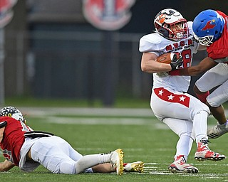 NILES, OHIO - JUNE 13, 2019: Trumbull County's Rob Savin is tackled by Mahoning County's Jordan Trowers after fighting off Josh Celli in the first half of their game, Thursday night at Niles McKinley High School. Trumbull County won 10-6. DAVID DERMER | THE VINDICATOR