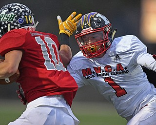 NILES, OHIO - JUNE 13, 2019: Trumbull County's Jarret Likens reaches to tackle Mahoning County's Josh Celli in the second half of their game, Thursday night at Niles McKinley High School. Trumbull County won 10-6. DAVID DERMER | THE VINDICATOR