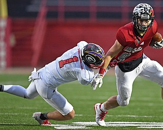 NILES, OHIO - JUNE 13, 2019: Mahoning County's Josh Lehwald is tackled by Trumbull County's Jarret Likens in the second half of their game, Thursday night at Niles McKinley High School. Trumbull County won 10-6. DAVID DERMER | THE VINDICATOR