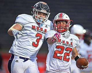 NILES, OHIO - JUNE 13, 2019: Trumbull County's Benton Tennant, center, celebrates with Marco Donatelli after a interception in the end zone in the second half of their game, Thursday night at Niles McKinley High School. Trumbull County won 10-6. DAVID DERMER | THE VINDICATOR