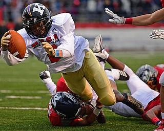 NILES, OHIO - JUNE 13, 2019: Trumbull County's Jeremy Wilson dives for the end zone to score a touchdown after running though Mahoning County's Dom Montalbano in the second half of their game, Thursday night at Niles McKinley High School. Trumbull County won 10-6. DAVID DERMER | THE VINDICATOR