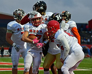 NILES, OHIO - JUNE 13, 2019: Trumbull County's Benton Tennant, center, is congratulated by Riley McCleary (66) Jeremy Wilson (2) Jakari Salter (7) and Marco Donatelli (3) after a interception in the end zone in the second half of their game, Thursday night at Niles McKinley High School. Trumbull County won 10-6. DAVID DERMER | THE VINDICATOR