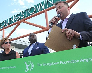 William D. Lewis the vindicator EricRyan, righjt, of JAC Management, speaks as Jan Strasfield of the Youngsotown foundation and mayor Tito Brown look on during ribbon cutting ceremony for  Youngstown foundation Amphitheater 6-14-19.