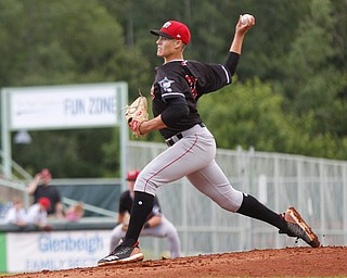 The Muckdogs' Eli Villalobos pitches during their game against the Scrappers at Eastwood Field on Sunday evening. EMILY MATTHEWS | THE VINDICATOR