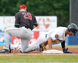 The Scrappers' Johnathan Rodriguez safely dives back to first before the Muckdogs' Evan Edwards could tag him during their game at Eastwood Field on Sunday evening. EMILY MATTHEWS | THE VINDICATOR