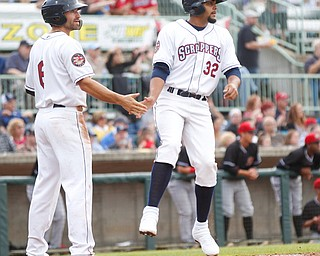 The Scrappers' Jonathan Engelmann, left, and Johnathan Rodriguez high-five after scoring during the second inning of their game against the Muckdogs at Eastwood Field on Sunday evening. EMILY MATTHEWS | THE VINDICATOR