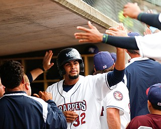 The Scrappers' Johnathan Rodriguez high-fives his teammates after scoring during the second inning of their game against the Muckdogs at Eastwood Field on Sunday evening. EMILY MATTHEWS | THE VINDICATOR