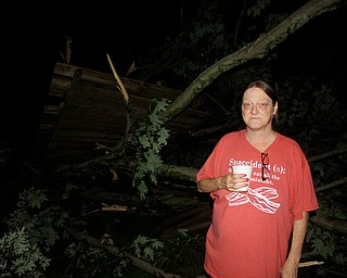 Angel Wargo, whose house is in another photo with a tree laying on it.  ED RUNYAN | THE VINDICATOR