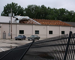 This Carrier Services building at 2927 Mahoning Avenue in Warren, just down the street from the Jamestown Giant Eagle, experienced significant damage to its roof and a metal fence during Sunday afternoon's storm. ED RUNYAN | THE VINDICATOR