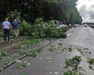 Passersby stopped to clear off 82 East before crews could get there. DUSTIN LIVESAY | THE VINDICATOR