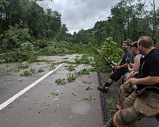 Workers take a break while tractors clear off 82 west. DUSTIN LIVESAY | THE VINDICATOR