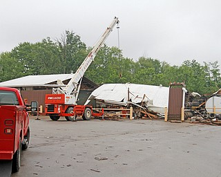 ROBERT K.YOSAY  | THE VINDICATOR..People from Warren to Brookfield are cleaning up after SundayÕs damaging winds after learning that the mess indeed was created by a tornado and possibly a series of touchdowns...