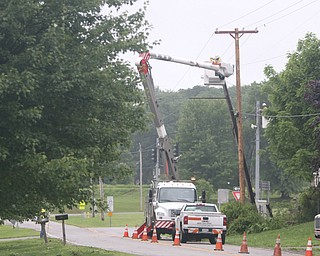 ROBERT K.YOSAY  | THE VINDICATOR..People from Warren to Brookfield are cleaning up after SundayÕs damaging winds after learning that the mess indeed was created by a tornado and possibly a series of touchdowns...Ohio Edison workers on Bedford Rd in Brookfield fix the pole and electric