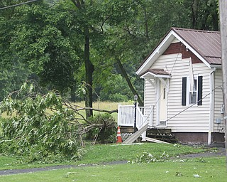 ROBERT K.YOSAY  | THE VINDICATOR..People from Warren to Brookfield are cleaning up after SundayÕs damaging winds after learning that the mess indeed was created by a tornado and possibly a series of touchdowns...house on Bedford Rd lost some siding and a tree