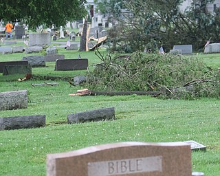 ROBERT K.YOSAY  | THE VINDICATOR..People from Warren to Brookfield are cleaning up after SundayÕs damaging winds after learning that the mess indeed was created by a tornado and possibly a series of touchdowns...trees toppled and headstones knocked down at Brookfield Cemetery