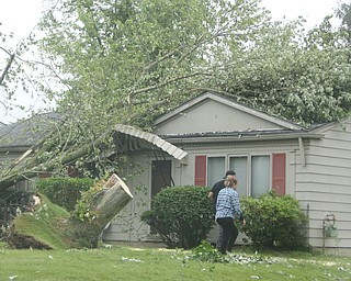 ROBERT K.YOSAY  | THE VINDICATOR..People from Warren to Brookfield are cleaning up after SundayÕs damaging winds after learning that the mess indeed was created by a tornado and possibly a series of touchdowns...the trees still on a house..that knocked down the awning and took out electric in warren Tod Ave area