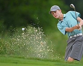 BOARDMAN, OHIO - JUNE 18, 2019: Alex Landry, of Andover, Massachusetts, shoots out of the bunker on on the 17th hole, Tuesday afternoon at Mill Creek Golf Course during he first round of the American Junior Golf Association Tournament. DAVID DERMER | THE VINDICATOR