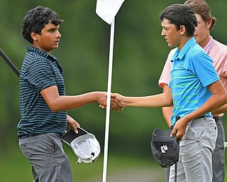 BOARDMAN, OHIO - JUNE 20, 2019: Asher Joseph. of Melbourne, Florida, left, shakes hands with Holden Kittelberger, of Katy, Texas, after the completion of the final round of the American Junior Golf Association Tournament. DAVID DERMER | THE VINDICATOR