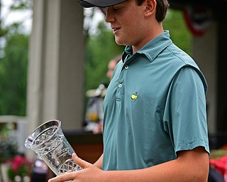 BOARDMAN, OHIO - JUNE 20, 2019: Jackson Finney, of Louisville, Kentucky, smiles after receiving his championship trophy after the completion of the final round of the American Junior Golf Association Tournament. DAVID DERMER | THE VINDICATOR