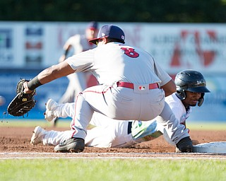 Scrappers' Korey Holland gets back to first before Doubledays' Albert Carrillo gets the ball during their game at Eastwood Field on Friday night. EMILY MATTHEWS | THE VINDICATOR