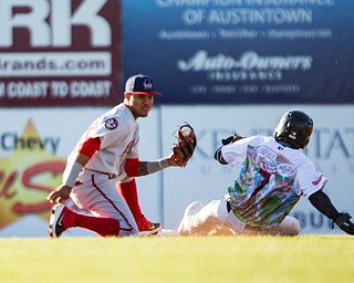 Scrappers' Korey Holland steals second before Doubledays' Jose Sanchez tags him during their game at Eastwood Field on Friday night. EMILY MATTHEWS | THE VINDICATOR