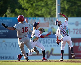 Scrappers' Brayan Rocchio grabs the ball with Raynel Delgado behind him as Doubledays' Jack Dunn runs to second during their game at Eastwood Field on Friday night. EMILY MATTHEWS | THE VINDICATOR