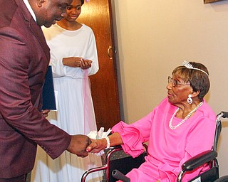 William D. Lewis The Vindicator Rev. Flonerra Henry-Harris shares a moment with Youngstown Mayor tito Brown. A 100th birthday party for Rev. Henry -Harris was held at Mahoning Country Club in Girard 6-21-19.