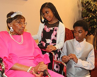 William D. Lewis The Vindicator Rev. Flonerra Henry-Harris shares a moment with two of her great grandchildren, Mercedes Spencer and her brother Elijah Spencer 13, of Youngstown. A 100th birthday party for Rev. Henry -Harris was held at Mahoning Country Club in Girard 6-21-19.
