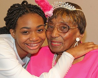William D. Lewis The Vindicator Rev. Flonerra Henry-Harris shares a moment  her great grandaughter,Trinity Spencer, 15, of Youngstown. A 100th birthday party for Rev. Henry -Harris was held at Mahoning Country Club in Girard 6-21-19.