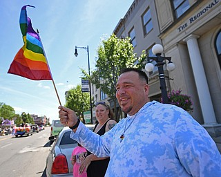 WARREN, OHIO - JUNE 22, 2019: Joseph Jackson, of Niles, waves a Pride flag during the start of the Pride parade around Courthouse square, Saturday afternoon during the Pride Festival. DAVID DERMER   THE VINDICATOR